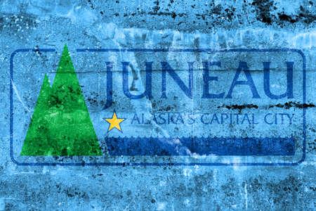 Flag of Juneau, Alaska, USA, painted on dirty wall
