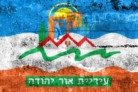 Flag of Or Yehuda, Israel, painted on dirty wall