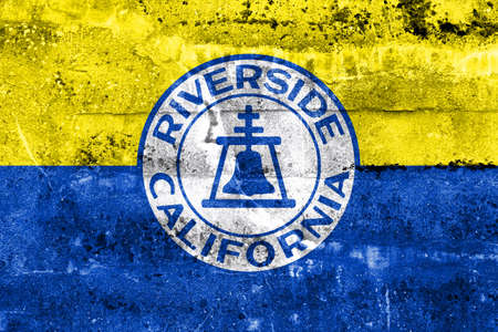 riverside county: Flag of Riverside, California, USA, painted on dirty wall Stock Photo