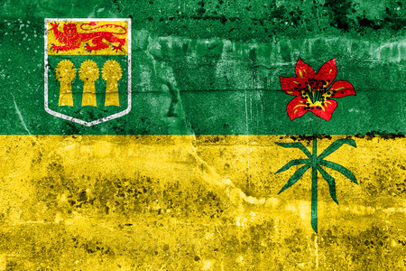 Flag of Saskatchewan Province, Canada, painted on dirty wall