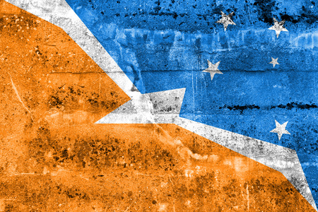tierra: Flag of Tierra del Fuego Province, Argentina, painted on dirty wall Stock Photo