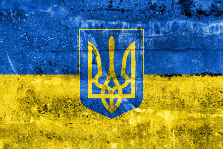 territory: Flag of Ukraine with Coat of Arms, painted on dirty wall