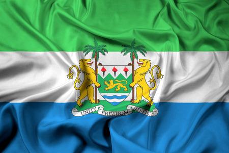 sierra leone: Waving Flag of Sierra Leone with Coat of Arms
