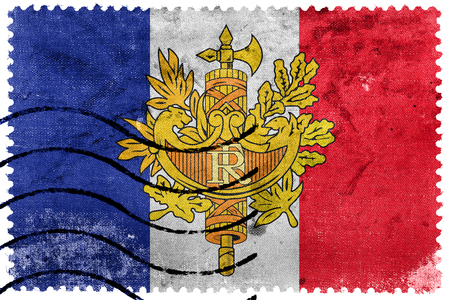 Flag of France with National Emblem, old postage stamp Stock Photo