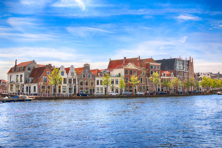 dutch typical: HAARLEM, NETHERLANDS - APR 30, 2017 : Canal with boats in Spring. Typical Dutch architecture. View from the boat level. Editorial