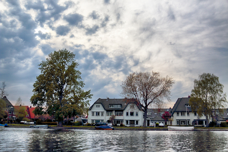 HAARLEM, NETHERLANDS - APR 30, 2017 : Canal with boats in Spring. Typical Dutch architecture. View from the boat level. Editorial