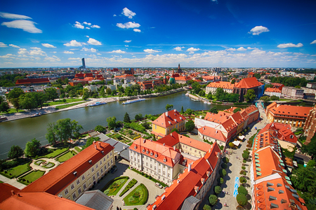 WROCLAW, POLAND - JULY 29, 2017: Aerial view of Wroclaw. Old Town and Cathedral Island (Ostrow Tumski) is the oldest part of the city. Odra River, boats and historic buildings on a summer day. Editorial