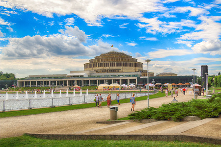 WROCLAW, POLAND - AUGUST 04, 2017: Centennial Hall and Multimedia Fountain. The Halls inscription on UNESCO World Heritage List in 2006 emphasized the rank of this facility. Designed by Max Berg. Editorial