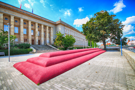 WROCLAW, POLAND - AUGUST 14, 2017: Maria and Lech Kaczynscy Boulevard. The building of the Voivodeship Office. One of the attractions is a city pouffe and large WRO sign.