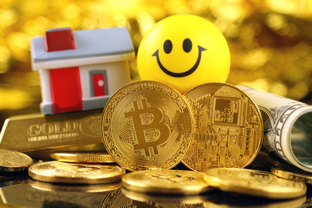 Conceptual image for investors in cryptocurrency (new virtual money), gold, real estate and dollars. Stock Photo