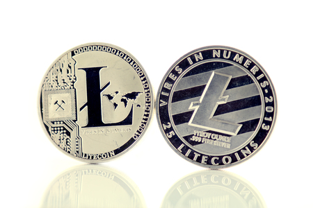 Physical version of Litecoin, new virtual money. Conceptual image for worldwide cryptocurrency and digital payment system called the first decentralized digital currency. Stock Photo