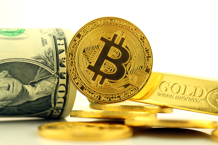 Physical version of Bitcoin, new virtual money. Conceptual image for investors in cryptocurrency, gold and dollars. Stock Photo