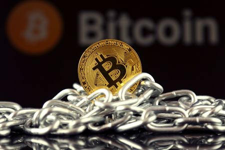 Physical version of Bitcoin (new virtual money) and chain. Conceptual image for investors in cryptocurrency and Blockchain Technology.