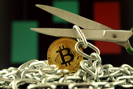 Physical version of Bitcoin, scissors and chain. Conceptual image for Blockchain Technology and hard fork (term refers to a situation when a blockchain splits into two separate chains). Stok Fotoğraf - 89147271