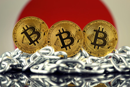 bandera japon: Physical version of Bitcoin (new virtual money), chain and Japan Flag. Conceptual image for investors in cryptocurrency and Blockchain Technology in Japan.