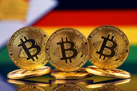 Physical version of Bitcoin (new virtual money) and Zimbabwe Flag. Conceptual image for investors in cryptocurrency and Blockchain Technology in Zimbabwe.