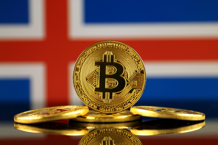 Physical version of Bitcoin (new virtual money) and Iceland Flag. Conceptual image for investors in cryptocurrency and Blockchain Technology in Iceland.