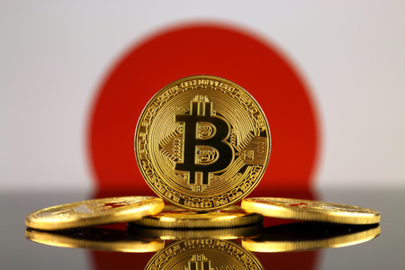 Physical version of Bitcoin (new virtual money) and Japan Flag. Conceptual image for investors in cryptocurrency and Blockchain Technology in Japan.