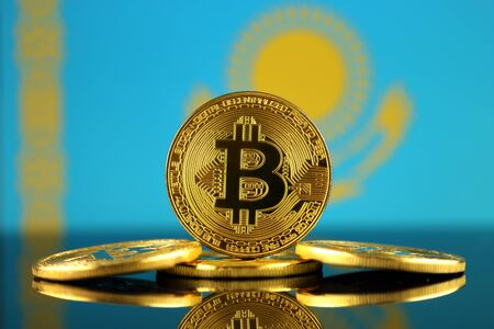 Physical version of Bitcoin (new virtual money) and Kazakhstan Flag. Conceptual image for investors in cryptocurrency and Blockchain Technology in Kazakhstan. Stock Photo