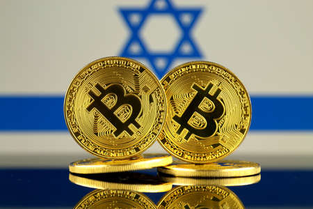 Physical version of Bitcoin and Israel Flag. Close up. Stock Photo