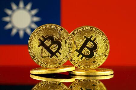 Physical version of Bitcoin and Taiwan Flag. Close up. Фото со стока