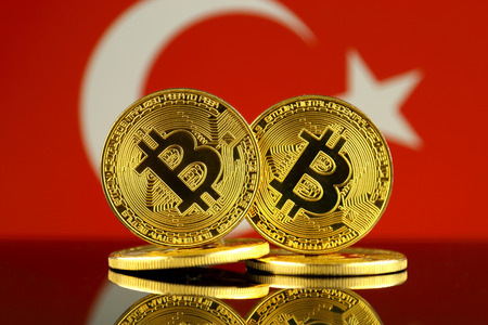 Physical version of Bitcoin and Turkey Flag. Close up.
