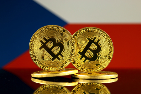 Physical version of Bitcoin and Czech Republic Flag. Close up.