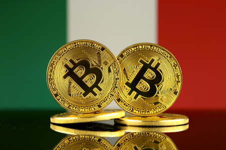Physical version of Bitcoin and Italy Flag. Close up. Imagens