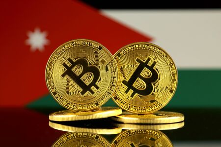 Physical version of Bitcoin and Jordan Flag. Close up. Stock Photo