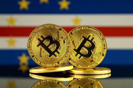 Physical version of Bitcoin and Cape Verde Flag. Close up.