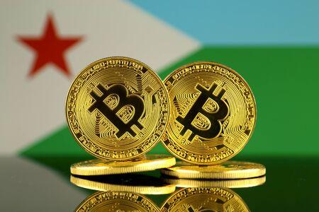 Physical version of Bitcoin and Djibouti Flag. Close up.