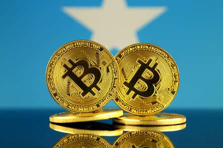 Physical version of Bitcoin and Somalia Flag. Close up. Stock Photo