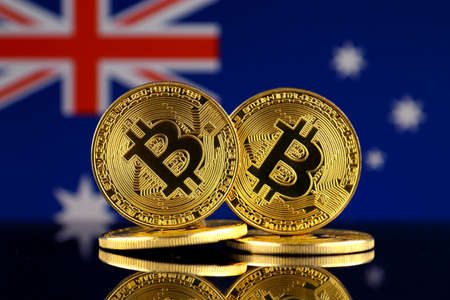 Physical version of Bitcoin and Australia Flag. Close up.