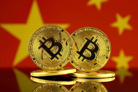 Physical version of Bitcoin and China Flag. Close up. Фото со стока