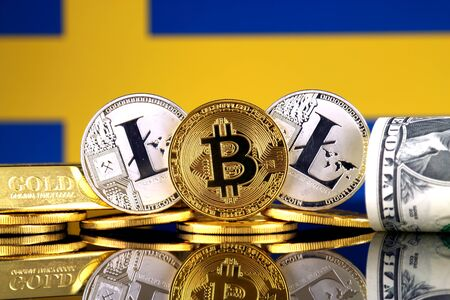 Physical version of Bitcoin, Litecoin, gold, US Dollar and Sweden Flag. Conceptual image for investors in cryptocurrency, gold and dollars.