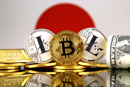 Physical version of Bitcoin, Litecoin, gold, US Dollar and Japan Flag. Conceptual image for investors in cryptocurrency, gold and dollars.