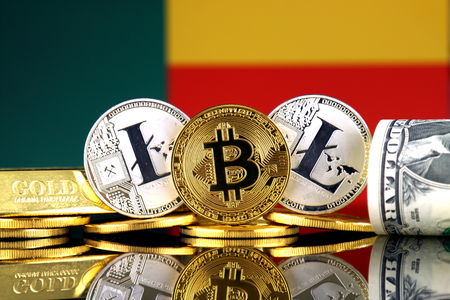 Physical version of Bitcoin, Litecoin, gold, US Dollar and Benin Flag. Conceptual image for investors in cryptocurrency, gold and dollars. Stock Photo