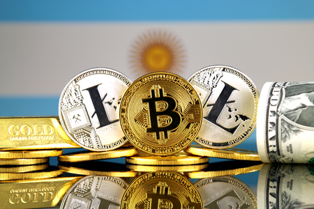 Physical version of Bitcoin, Litecoin, gold, US Dollar and Argentina Flag. Conceptual image for investors in cryptocurrency, gold and dollars.