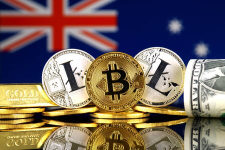 Physical version of Bitcoin, Litecoin, gold, US Dollar and Australia Flag. Conceptual image for investors in cryptocurrency, gold and dollars.