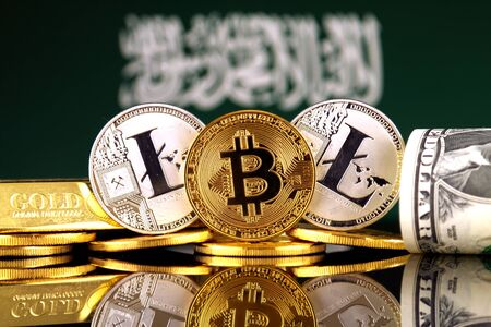 Physical version of Bitcoin, Litecoin, gold, US Dollar and Saudi Arabia Flag. Conceptual image for investors in cryptocurrency, gold and dollars.
