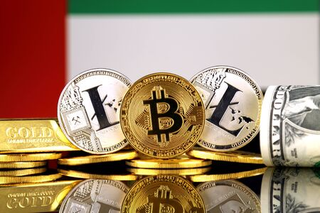 Physical version of Bitcoin, Litecoin, gold, US Dollar and United Arab Emirates Flag. Conceptual image for investors in cryptocurrency, gold and dollars.