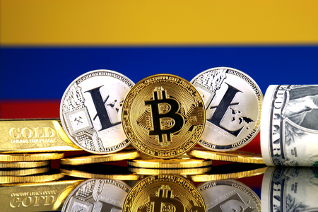 Physical version of Bitcoin, Litecoin, gold, US Dollar and Colombia Flag. Conceptual image for investors in cryptocurrency, gold and dollars.