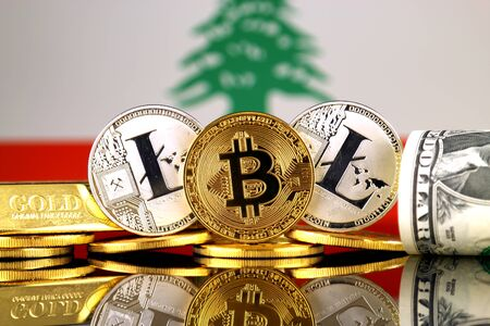 Physical version of Bitcoin, Litecoin, gold, US Dollar and Lebanon Flag. Conceptual image for investors in cryptocurrency, gold and dollars.