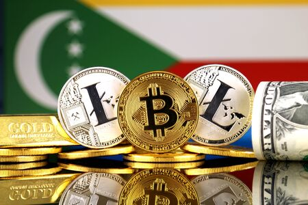 Physical version of Bitcoin, Litecoin, gold, US Dollar and Comoros Flag. Conceptual image for investors in cryptocurrency, gold and dollars.