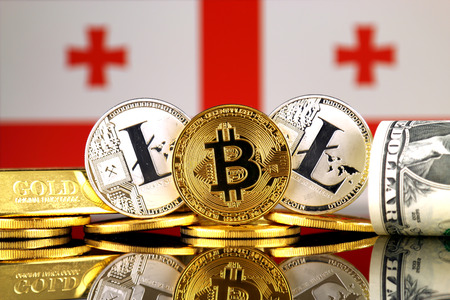 Physical version of Bitcoin, Litecoin, gold, US Dollar and Georgia Flag. Conceptual image for investors in cryptocurrency, gold and dollars.