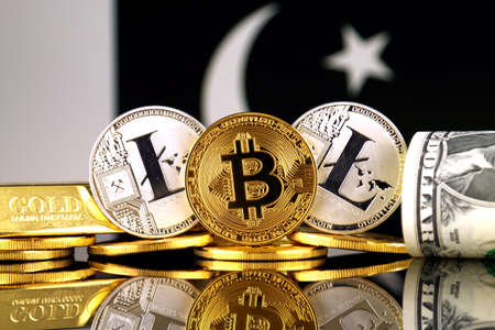 Physical version of Bitcoin, Litecoin, gold, US Dollar and Pakistan Flag. Conceptual image for investors in cryptocurrency, gold and dollars. Stock Photo