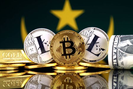 Physical version of Bitcoin, Litecoin, gold, US Dollar and Mauritania Flag. Conceptual image for investors in cryptocurrency, gold and dollars. Stock Photo
