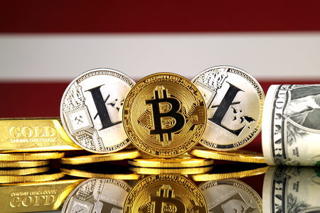 Physical version of Bitcoin, Litecoin, gold, US Dollar and Latvia Flag. Conceptual image for investors in cryptocurrency, gold and dollars. Stock Photo
