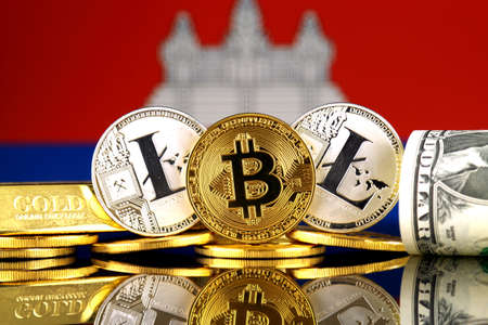 Physical version of Bitcoin, Litecoin, gold, US Dollar and Cambodia Flag. Conceptual image for investors in cryptocurrency, gold and dollars. Stock Photo