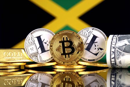 Physical version of Bitcoin, Litecoin, gold, US Dollar and Jamaica Flag. Conceptual image for investors in cryptocurrency, gold and dollars.